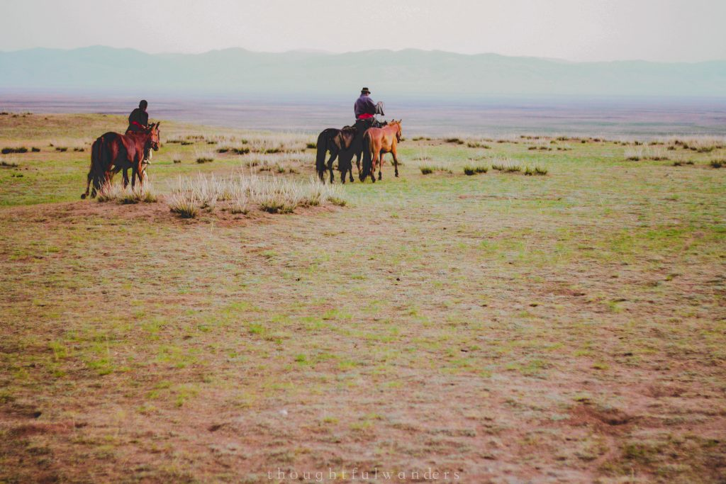 Mongolians riding horses