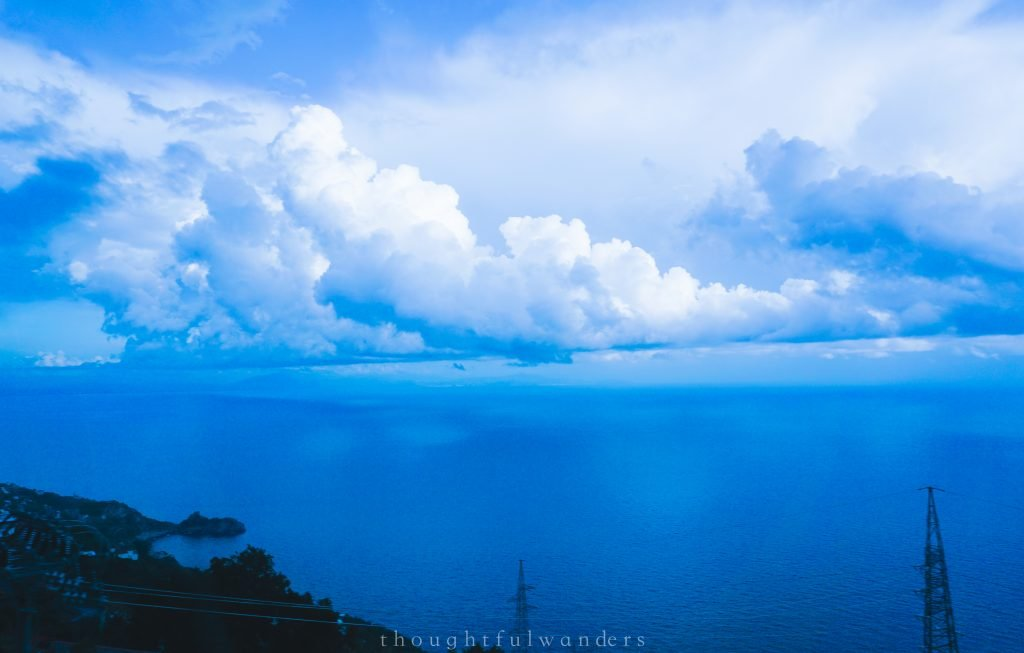 white fluffy cloud over ocean amalfi coast