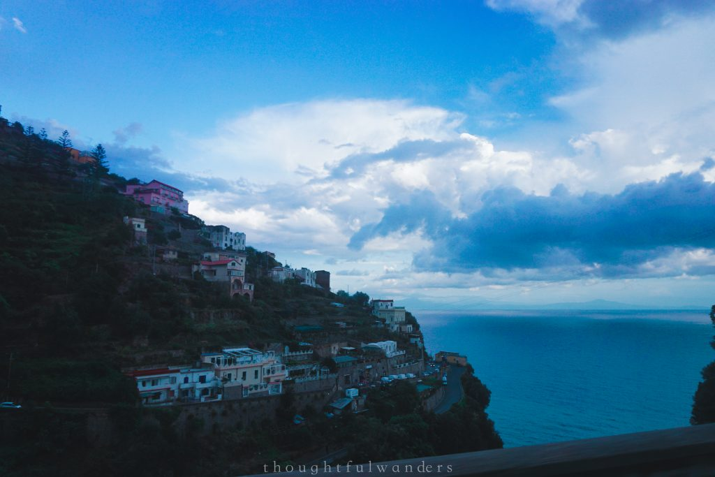Amalfi Coast drive view buildings on cliff and ocean in background