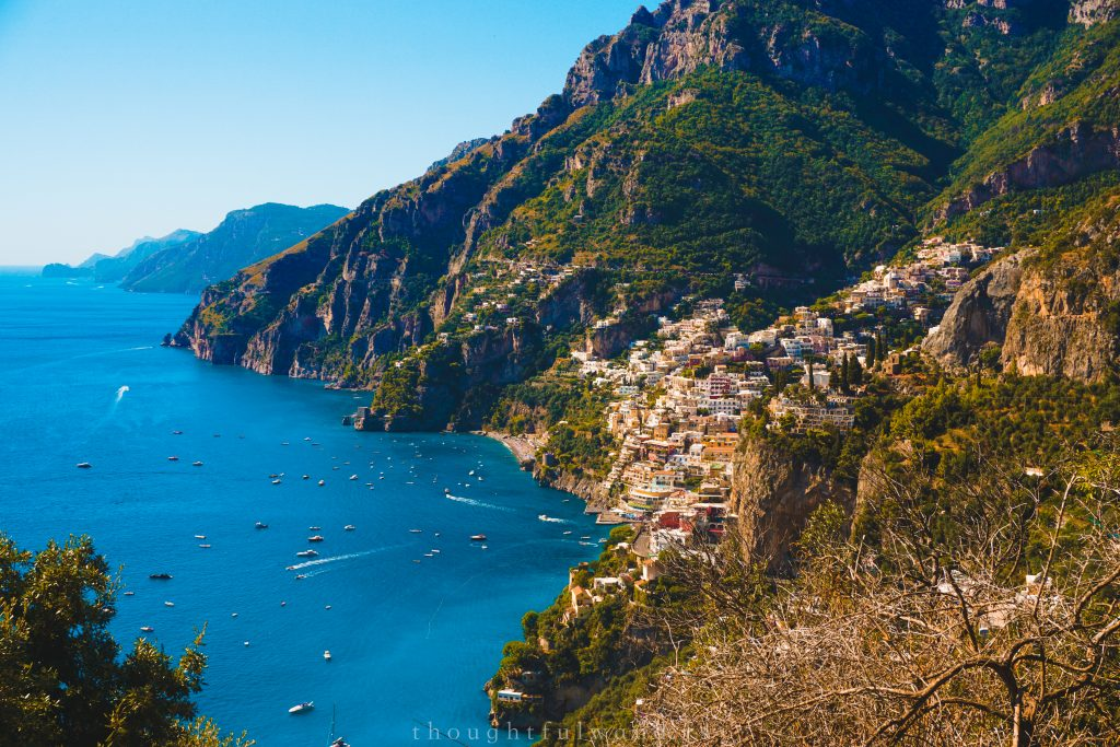 Colorful Positano against green mountains and blue oceans