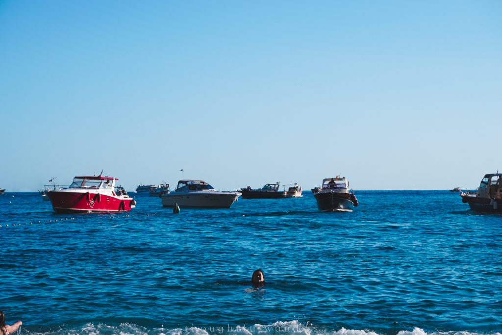 Asian woman swimming in the Mediterranean ocean Amalfi Coast