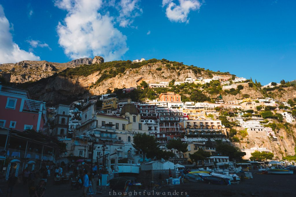 Positano close up colorful buildings half under the sun and half under the shadow