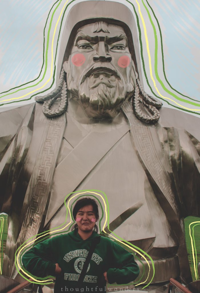 Asian girl posing with statue of Genghis Khan