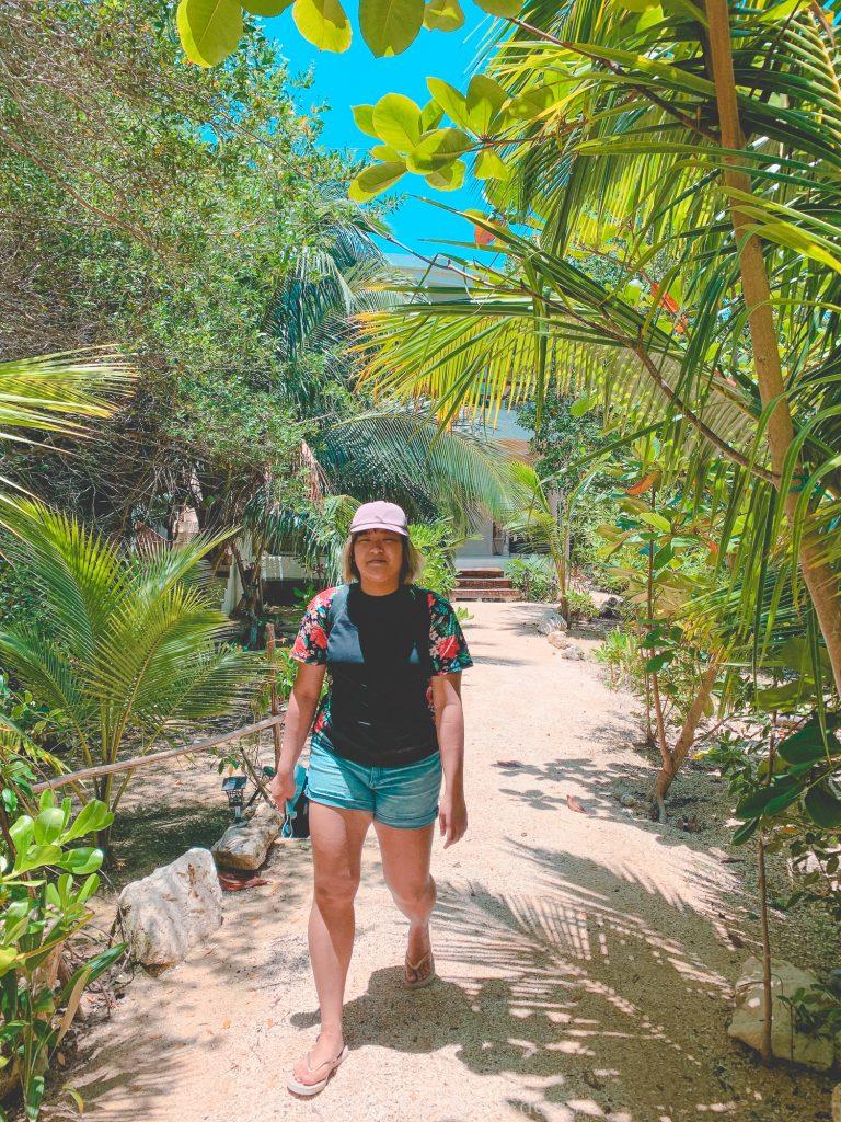 Asian woman in garden Isla Holbox