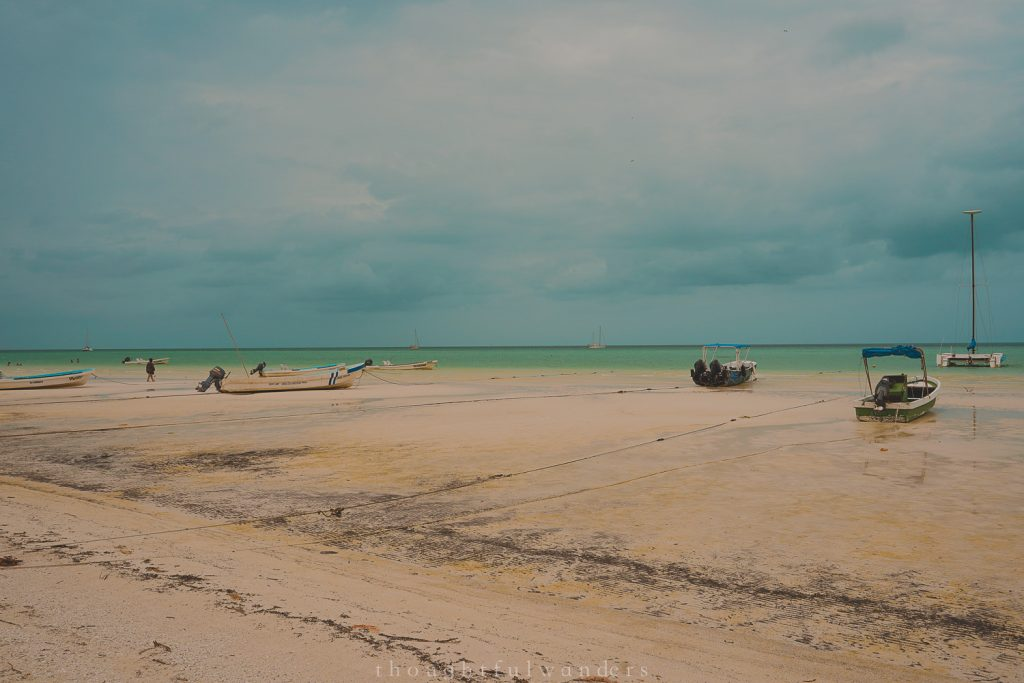 Boats on the beach Isla Holbox on a cloudy day and low tide