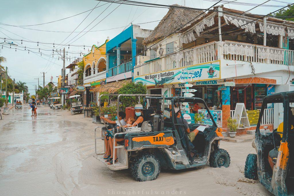 Holbox golf cart taxis driving through roads
